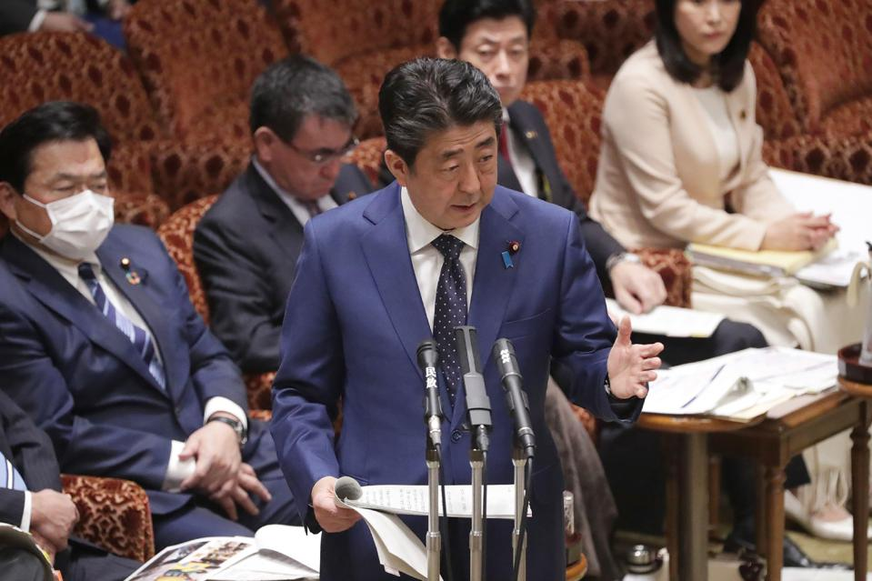 Japanese Prime Minister Shinzo Abe addresses parliament in Tokyo.