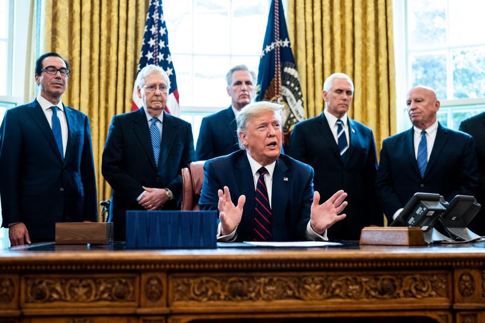 President Trump Signs Coronavirus Stimulus Bill In The Oval Office