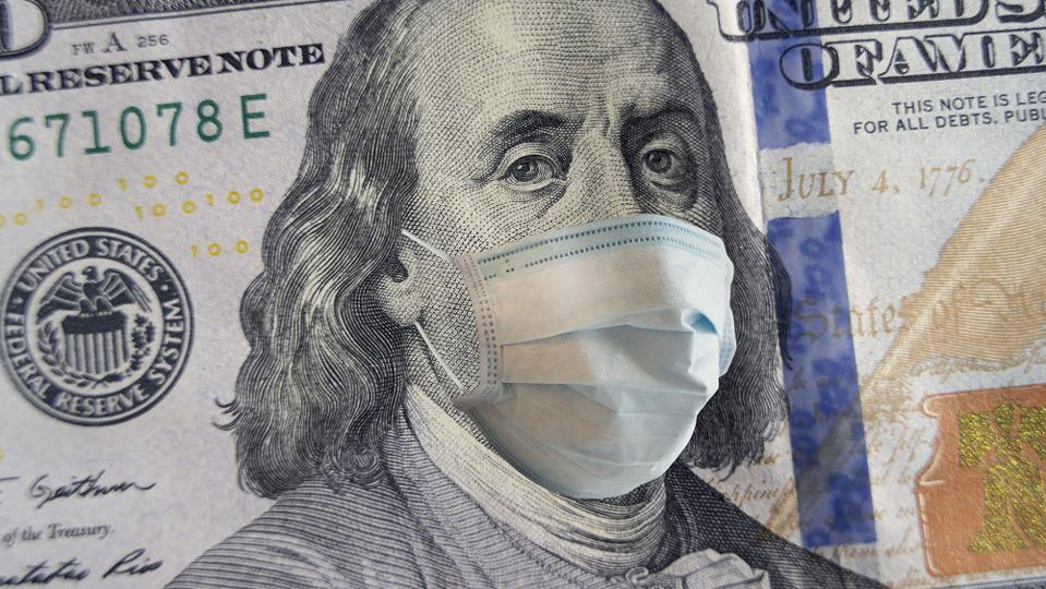 100 dollar banknote with a face mask. World crisis