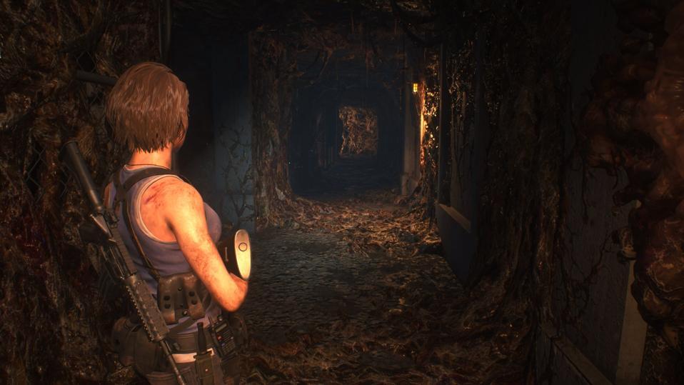 Jill looking down a meaty corridor in Resident Evil 3 2020.