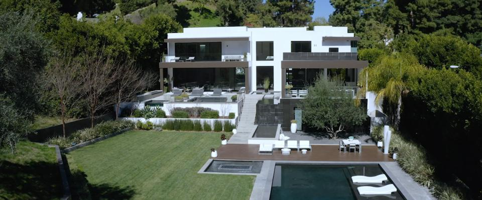 This Beverly Hills home has contemporary interiors and a massive backyard.