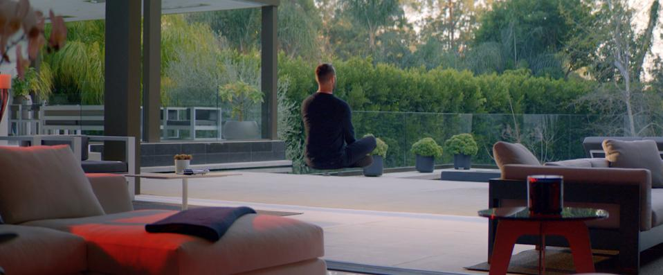 In the Star Wars spoof, Revel Real Estate's Ben Bacal inexplicably ″medvitates″ like a Jedi amid contemporary furniture and an expansive indoor-outdoor patio.