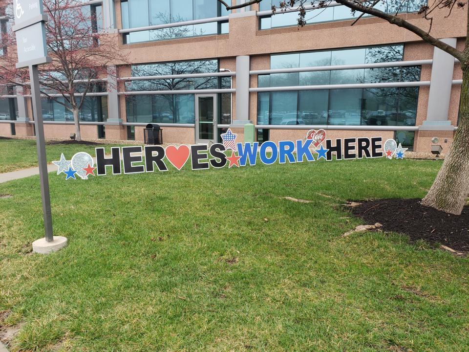 ″Heros Work Here″ sign outside HCA Midwest Health Menorah Medical Center