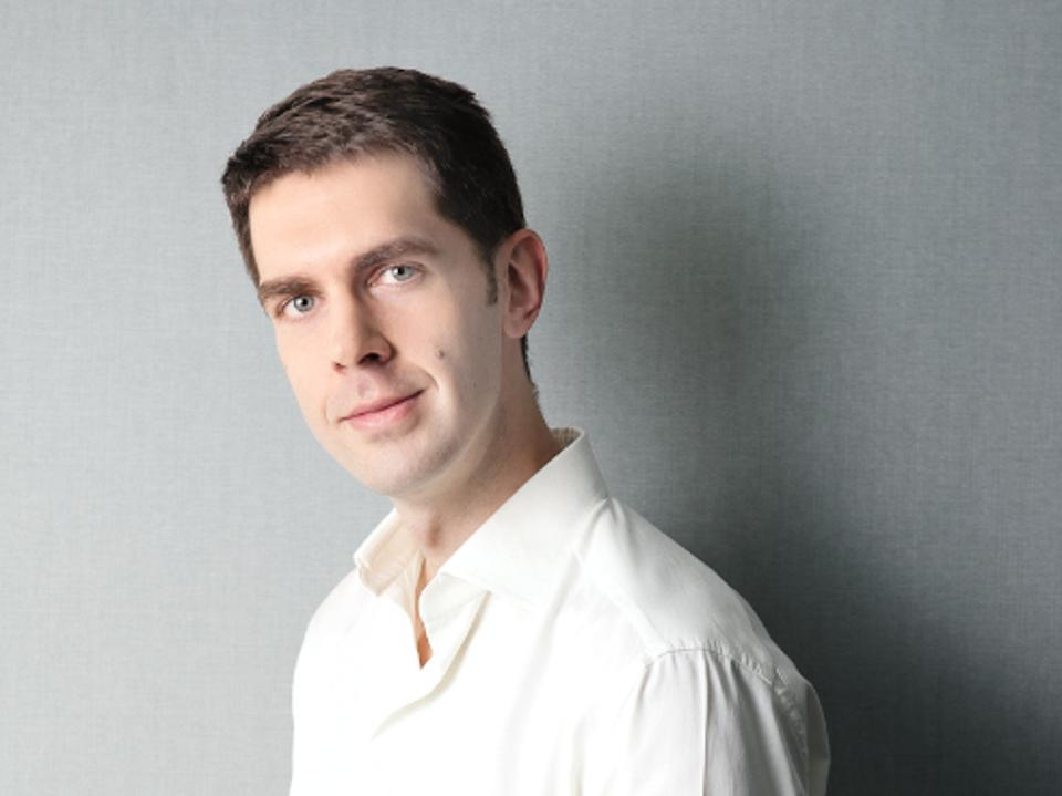 Headshot of Grabowski against a grey background.