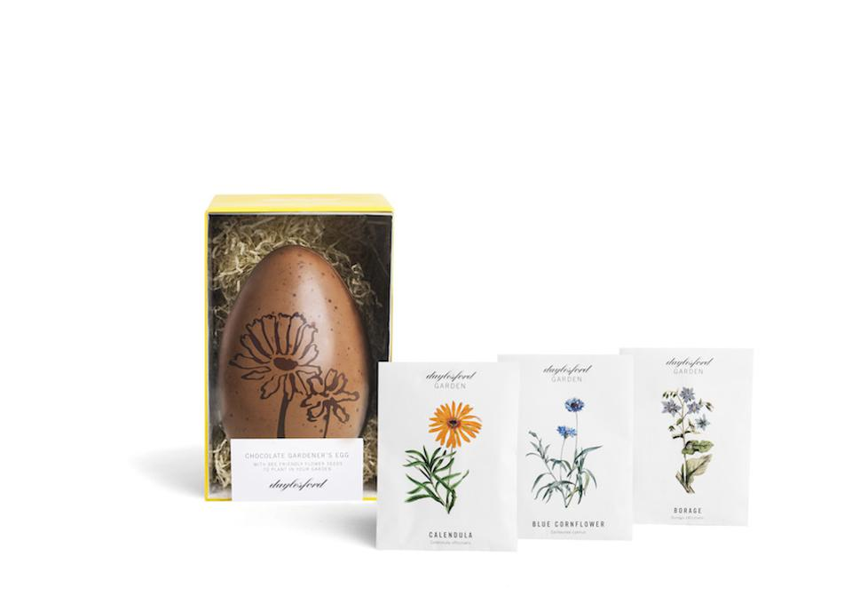 chocolate easter egg with three packages of seeds