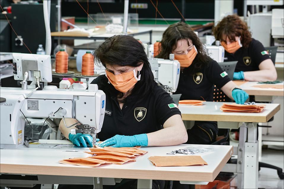 The ladies of Lamborghini stitching up medical masks.