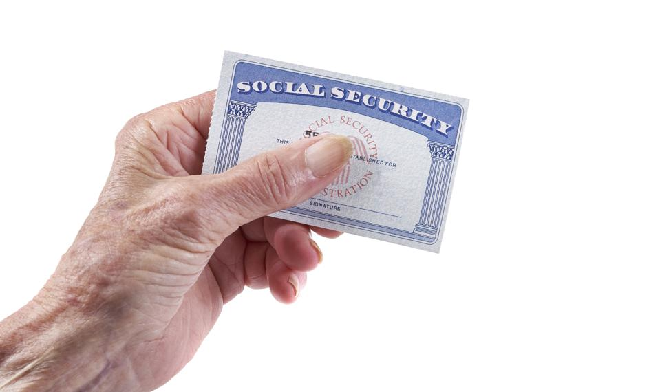 Social Security Card: Senior woman holding card in hand on white background