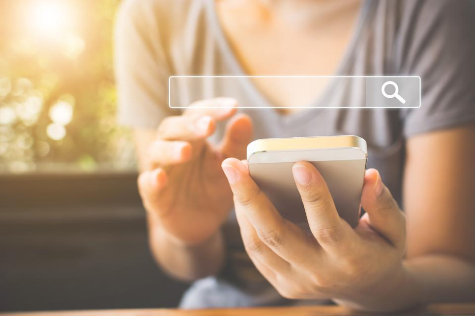 Women use smartphones. Grow traffic to your website