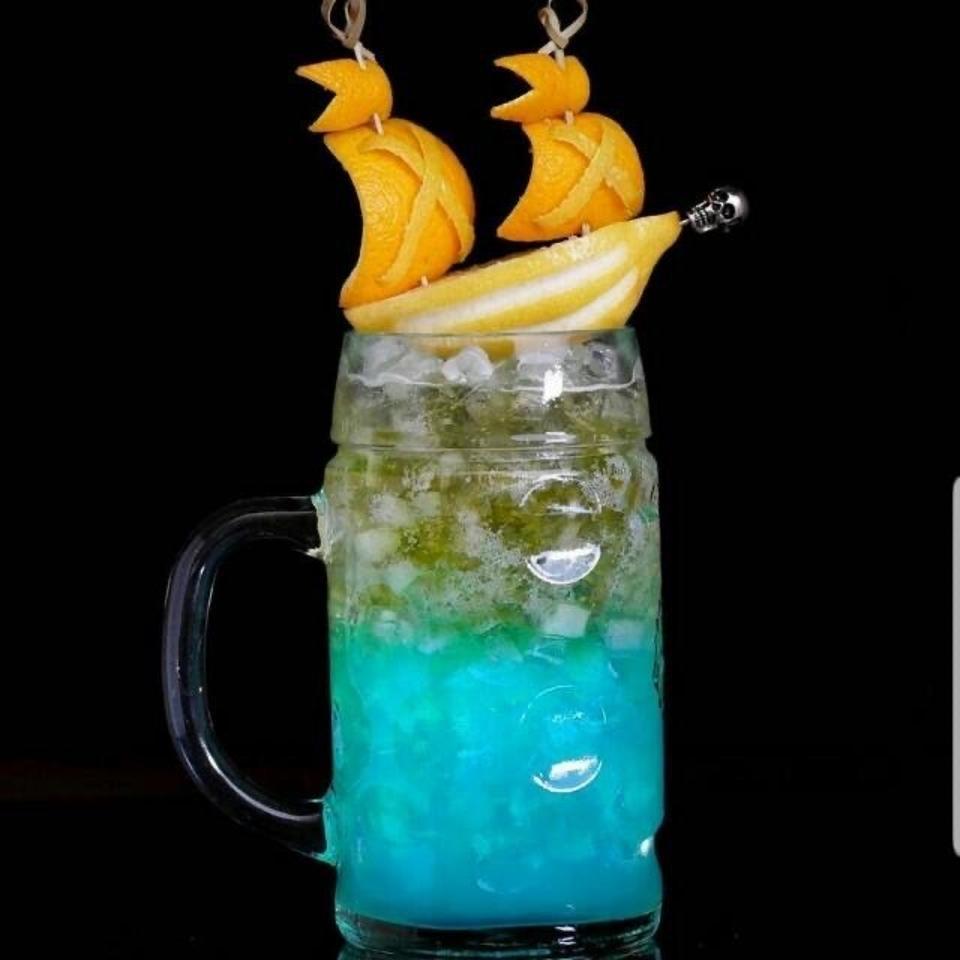 Rum cocktail with orange garnish