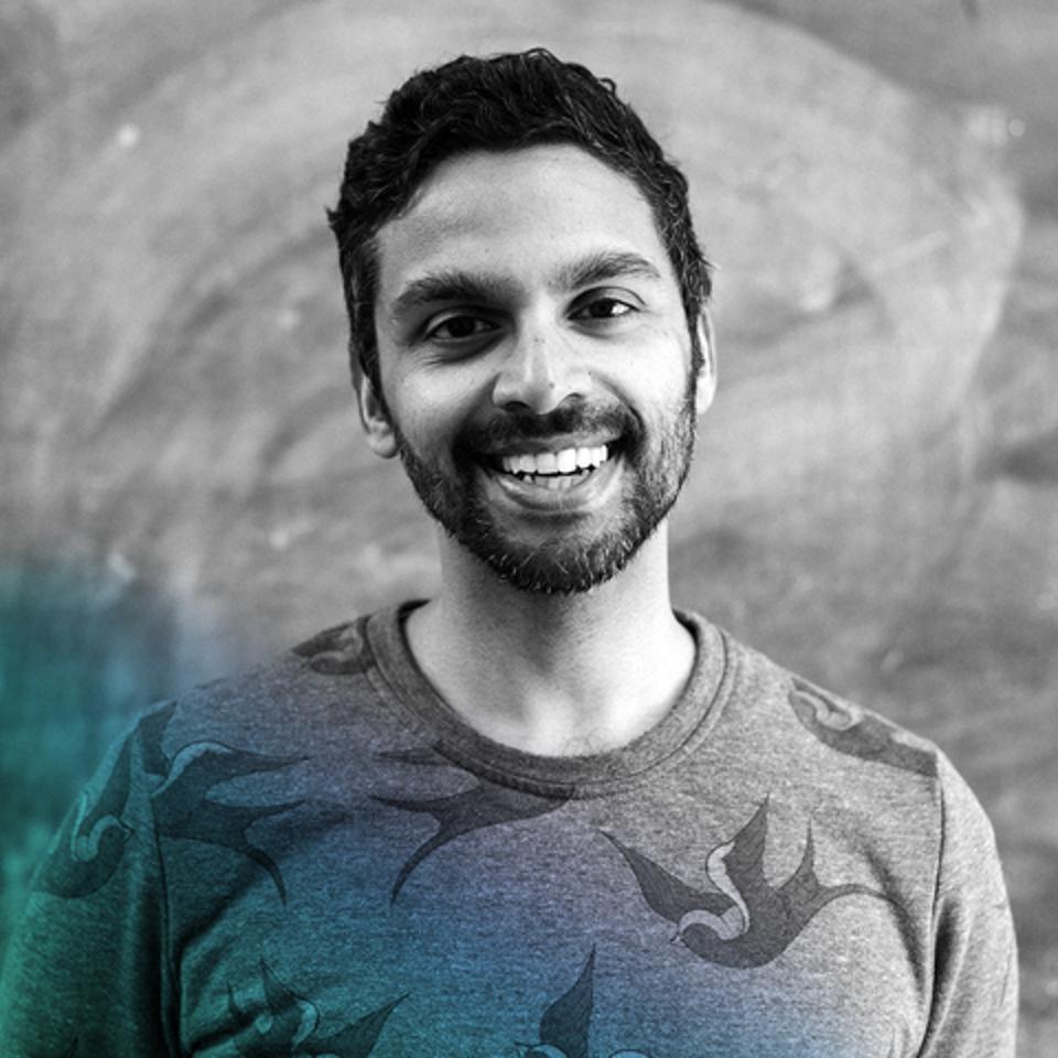 A headshot of Meditative Story Host Rohan Gunatillake