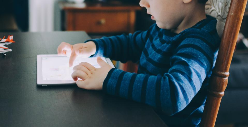 Young boy working on a tablet
