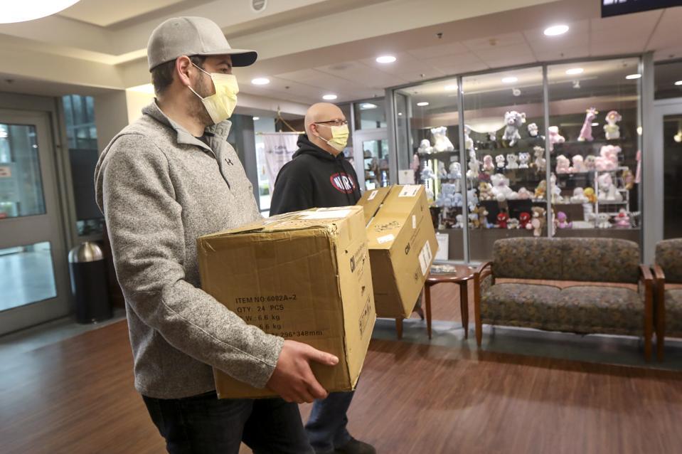 Men deliver donated face masks to hospital during pandemic