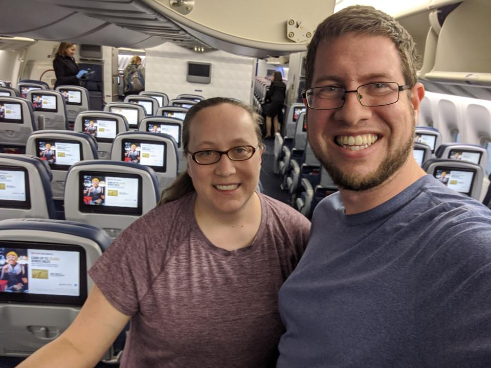JT Genter and his wife, Katie, on their flight from South Africa to the U.S. during the coronavirus pandemic.