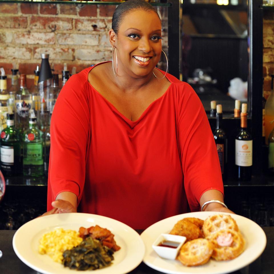 Melba Wilson serves up food at her eponymous restaurant in Harlem, New York City.
