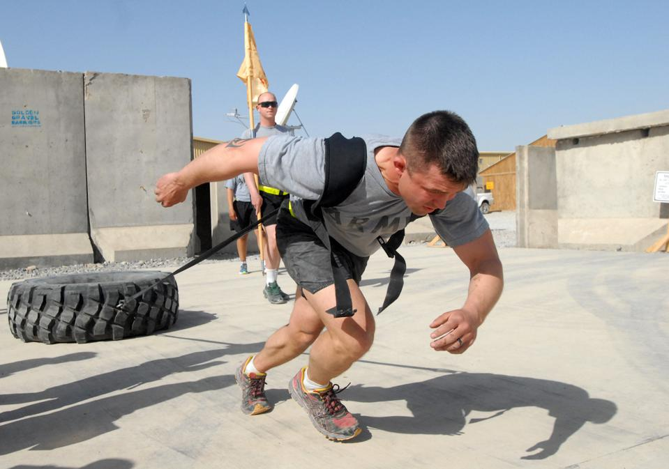 Person pulling a tire for exercise