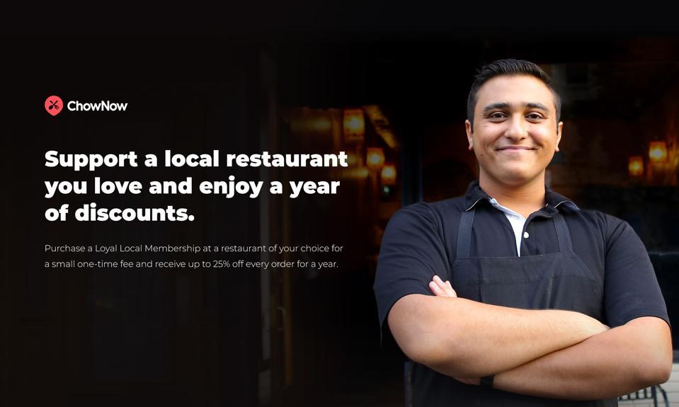 A restaurant owner smiling