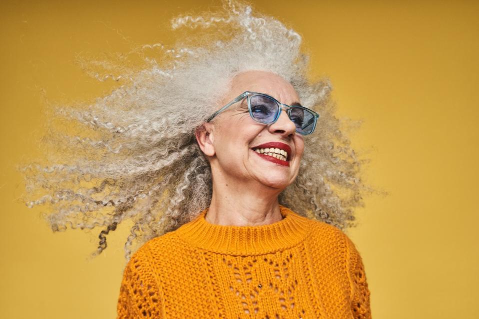 Colourful studio portrait of a senior woman
