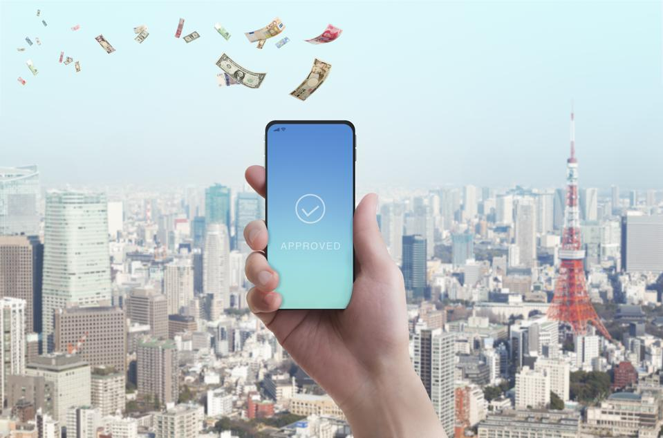 Mobile payment. Woman's hand has smartphone with banknote in the sky.