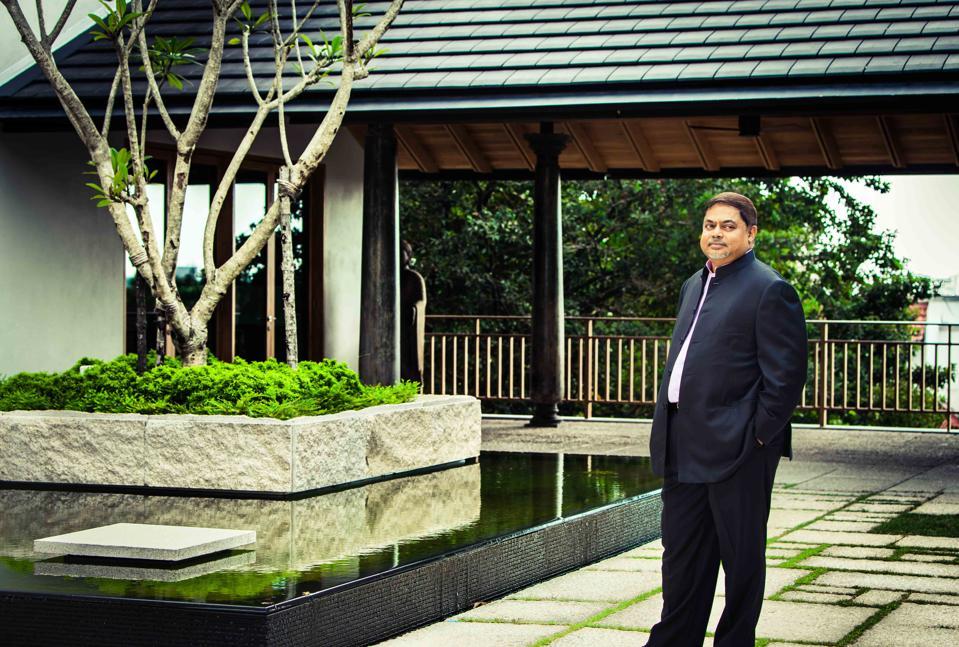 Vijay Eswaran at his home—built to include nature at its center.