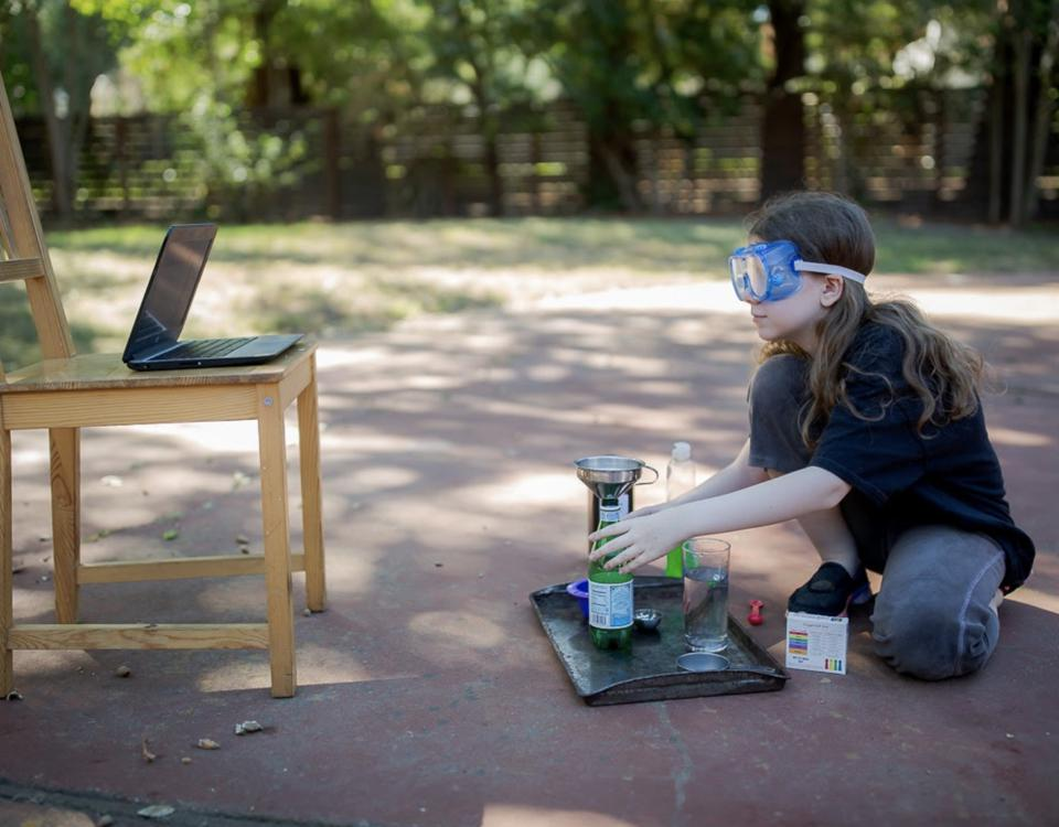 Student participating in virtual science class
