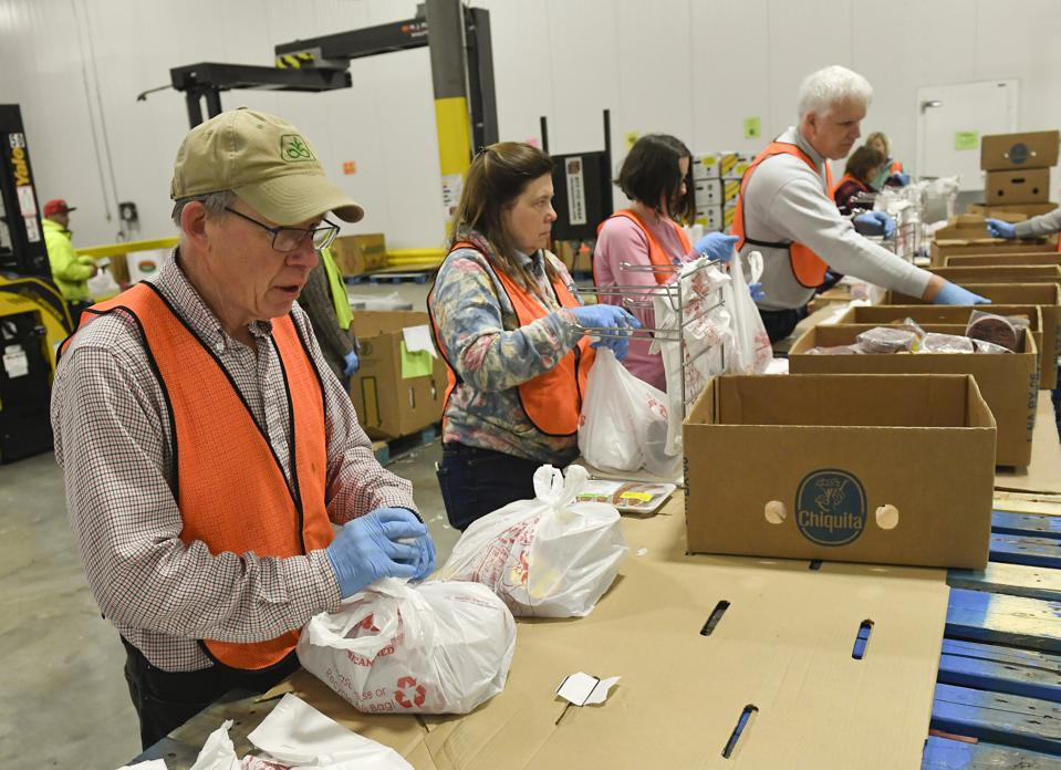Volunteers Pack Food At Food Bank