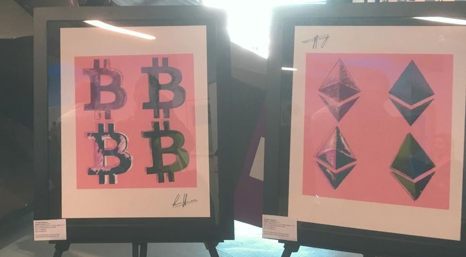 Bitcoin and Ethereum themed artwork by Thomas H on display at Block Con 2018.
