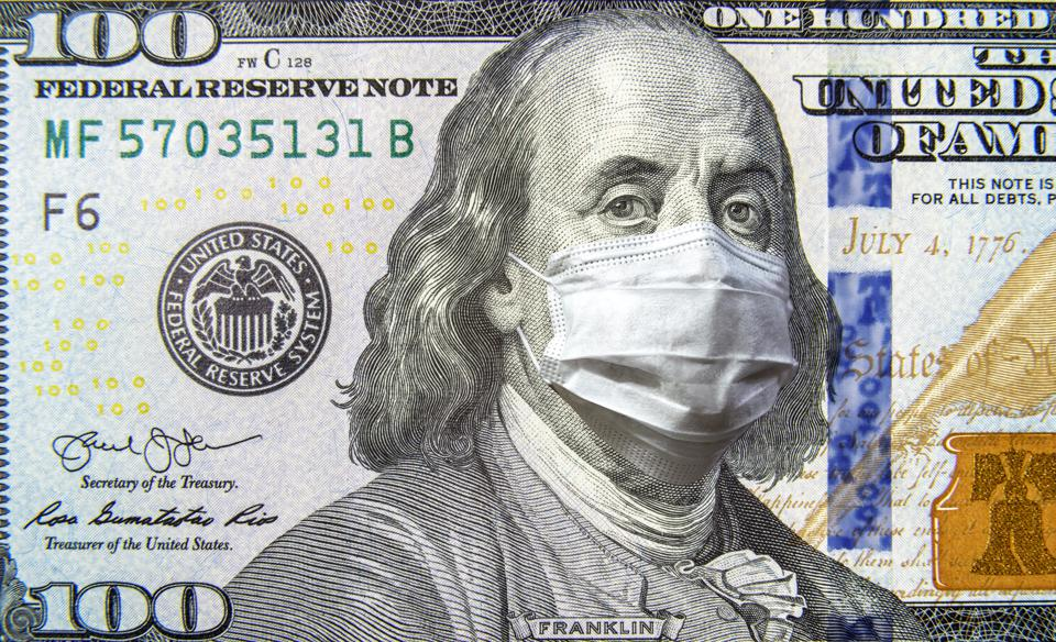COVID-19 coronavirus in USA, 100 dollar money bill with face mask.