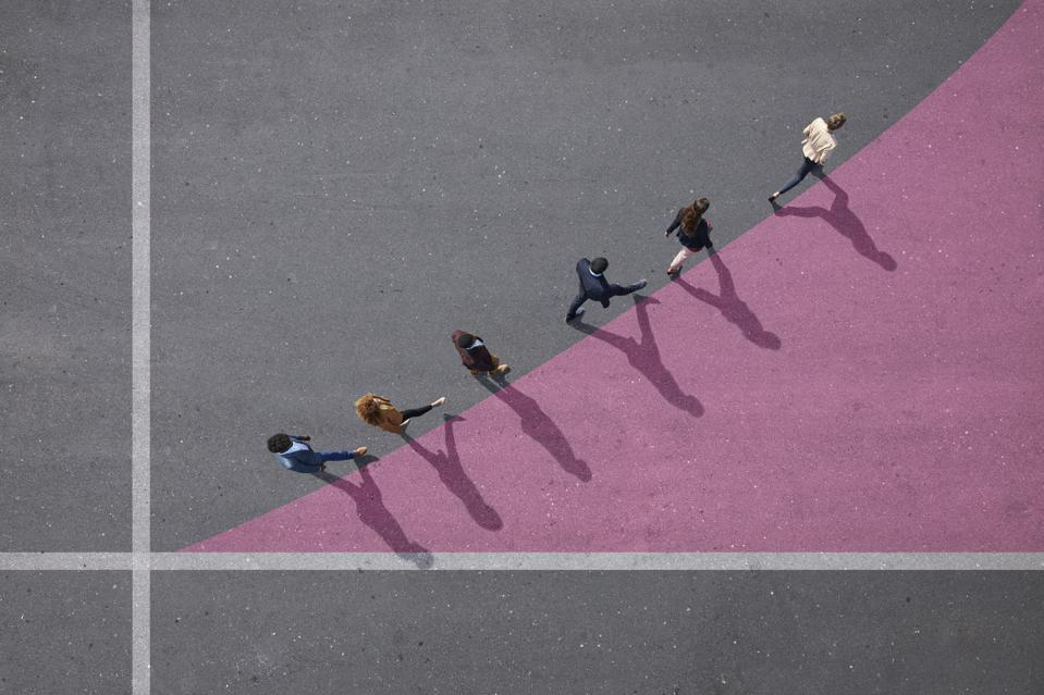 Businesspeople walking on painted up going graph, on asphalt