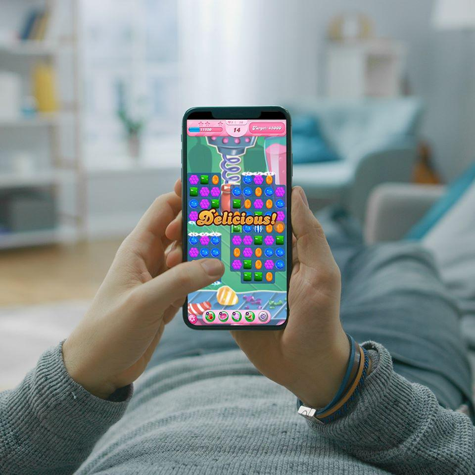 A user playing a King mobile game.