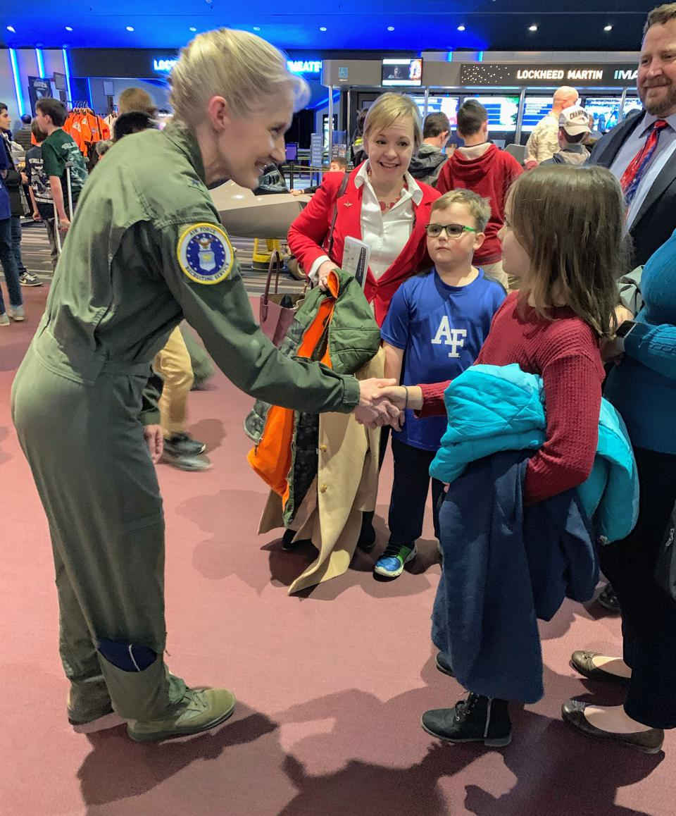 Major General Jeannie Leavitt greets a young girl at the Air Force Museum.