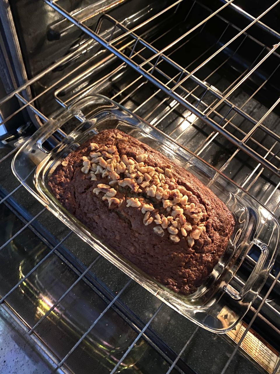 Aurora James makes banana bread straight out of the oven in Brooklyn.  Cooking and coping.