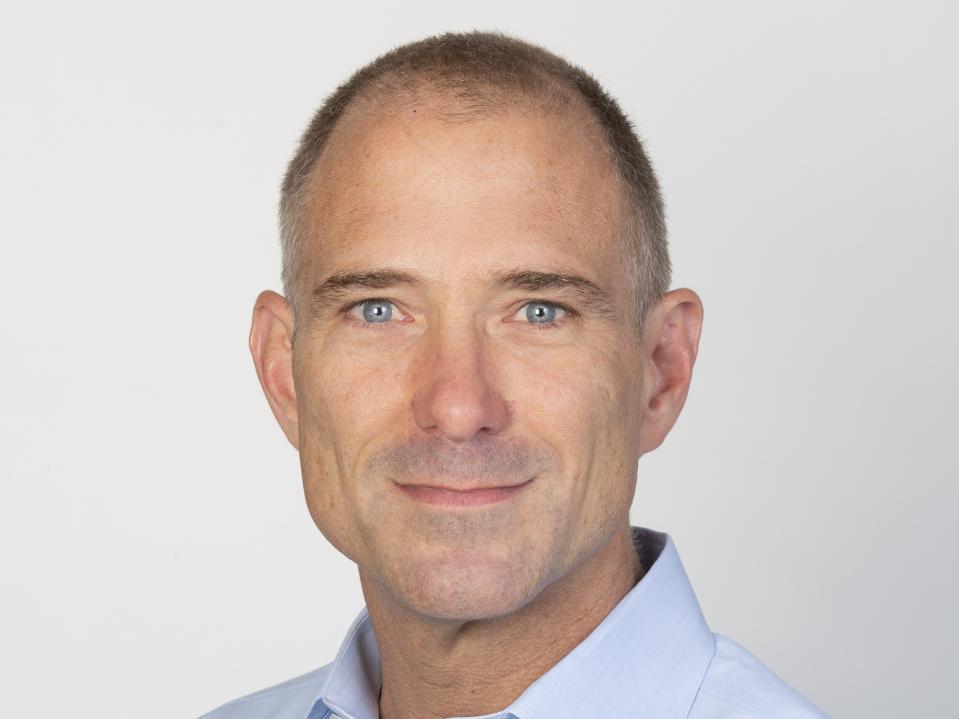 Headshot of Feegel in a blue button-down shirt.