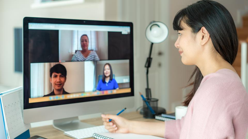 Multiethnic business team using computer for a online meeting in video call. Group of smart people working from home.
