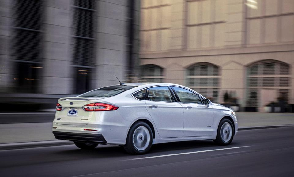 The Ford Fusion trunklid extends down flush with the rear bumper, but it features a plastic sacrifice panel to absorb minor impacts