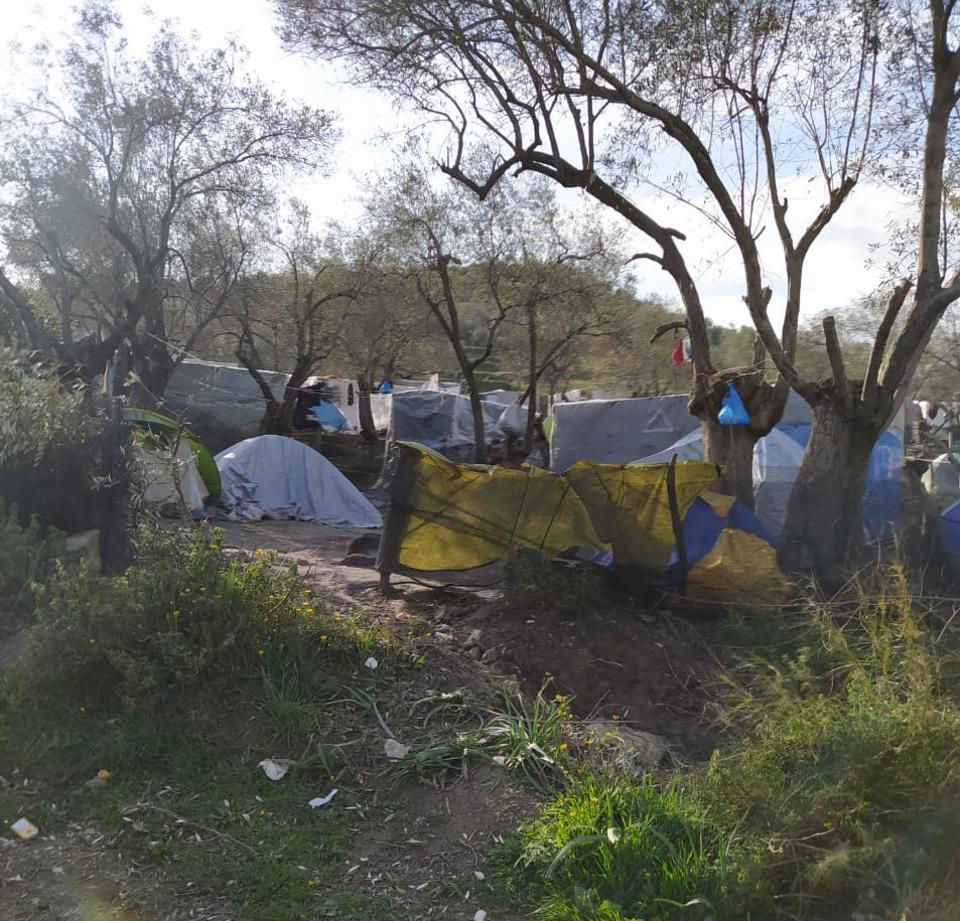 Tents and makeshift shelters in the woods around Moria detention center.