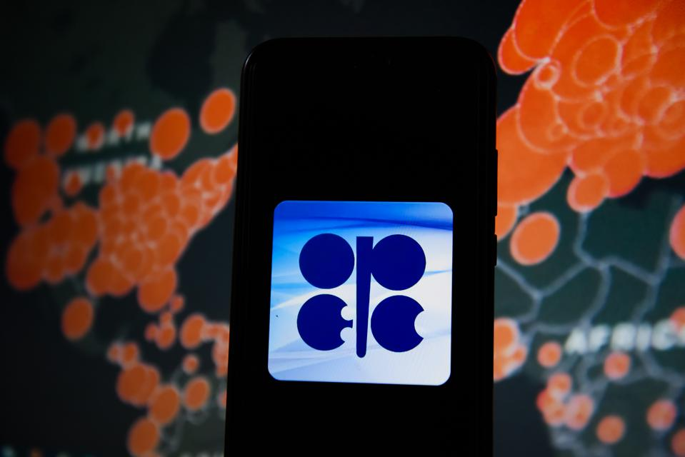 In this photo illustration an OPEC logo seen displayed on a...