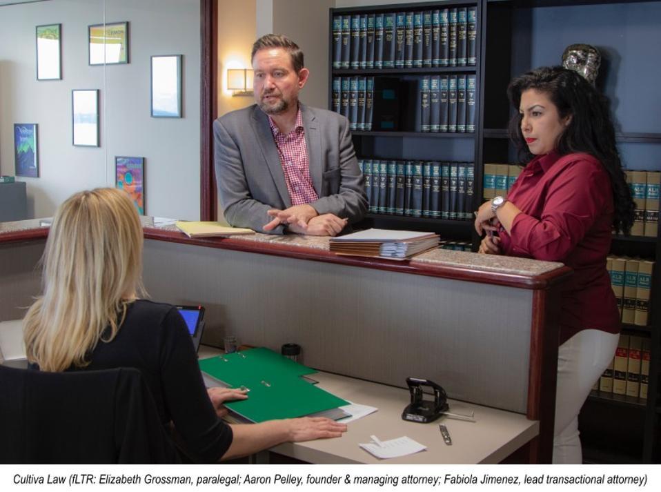 Fabiola, Aaron and Elizabeth in the law office