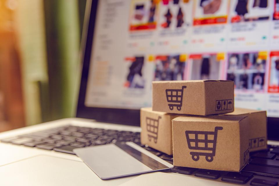 Shopping online concept - Payment by credit card and offers home delivery. shopping cart
