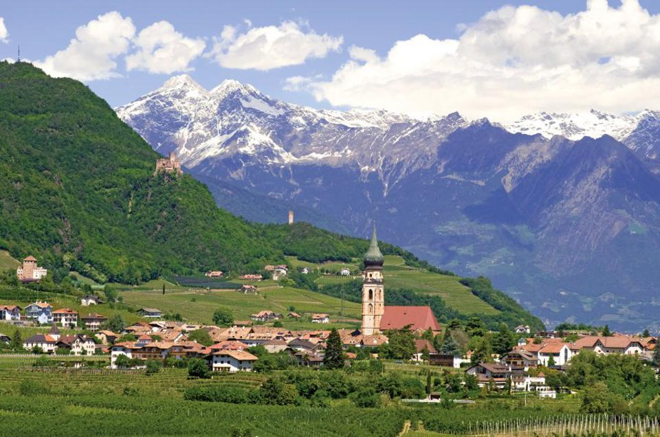 The village of St. Pauls in Alto Adige, set amidst the Dolomite Mountains
