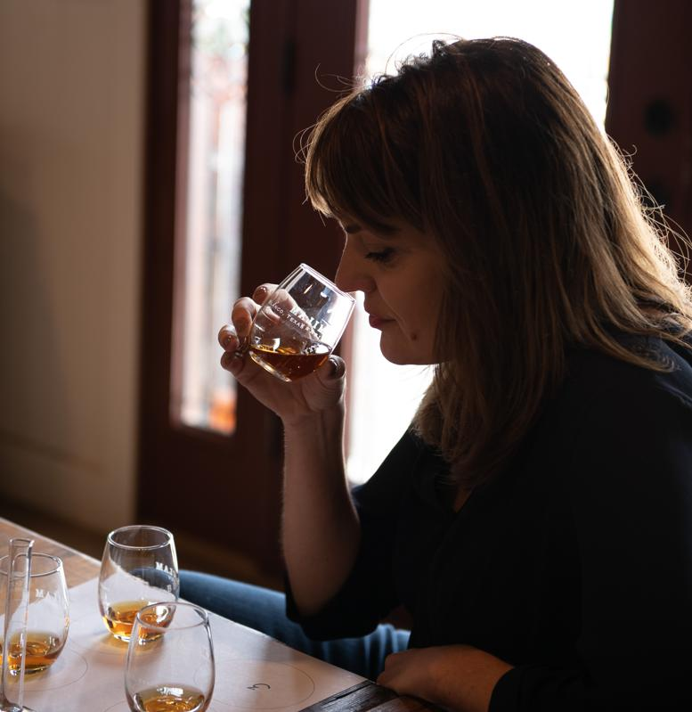 Heather Greene smelling a glass of Bourbon whiskey