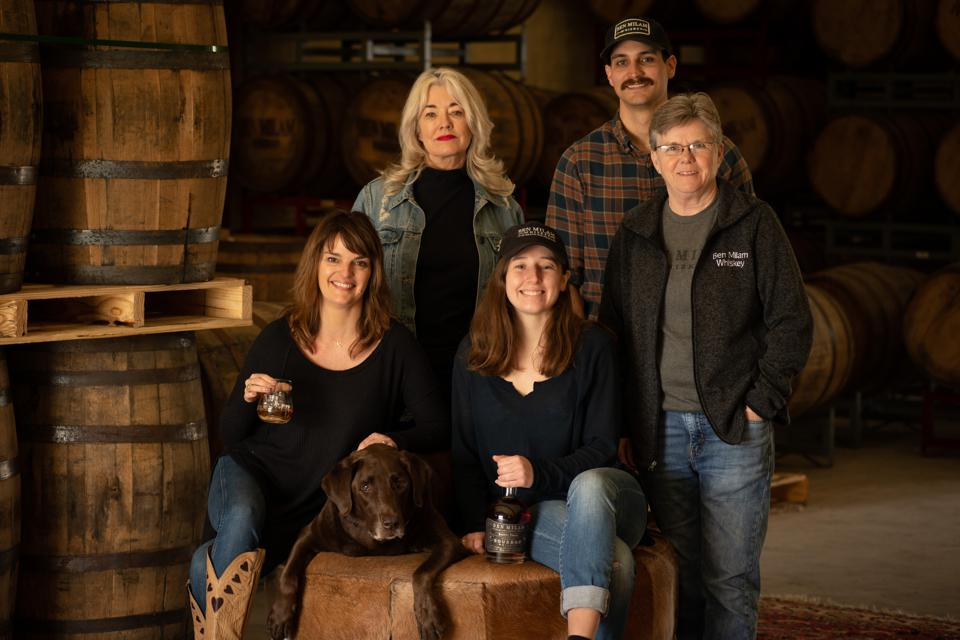 Group of people in a whiskey distillery