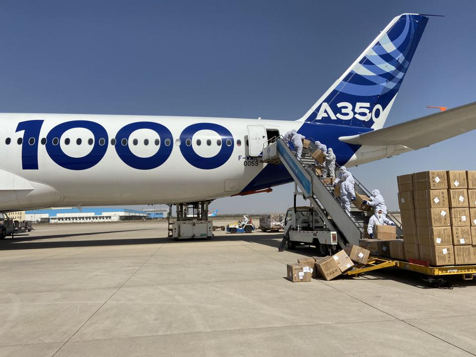 Airbus manually loads boxes of medical supplies at Tianjin, China onto an A350-1000