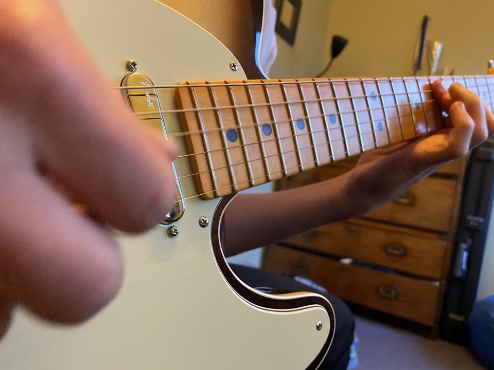 Boy Practices Guitar