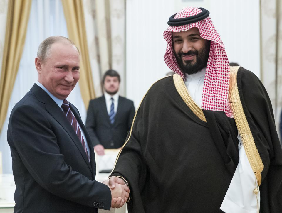 Russian President Vladimir Putin (L) shakes hands with Saudi Deputy Crown Prince and Defence Minister Mohammed bin Salman during a meeting at the Kremlin in Moscow on May 30, 2017. / AFP PHOTO / POOL / Pavel Golovkin (Photo credit should read PAVEL GOLOVKIN/AFP/Getty Images) GETTY
