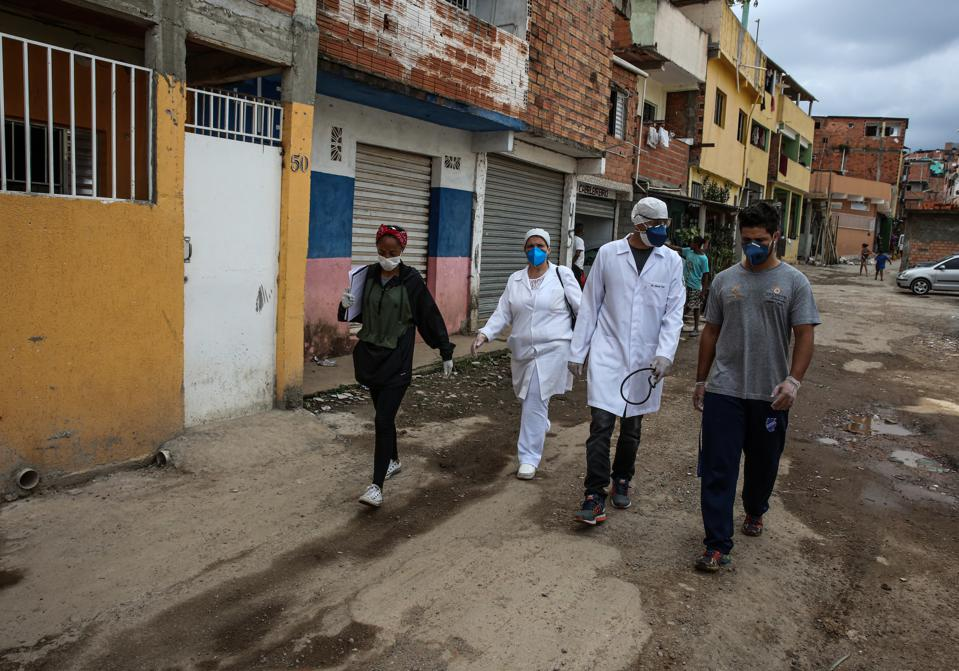 Doctors and Nurses Hired by G10 Go Door to Door to See Patients in Paraisopolis Amidst the Coronavirus (COVID - 19) Pandemic