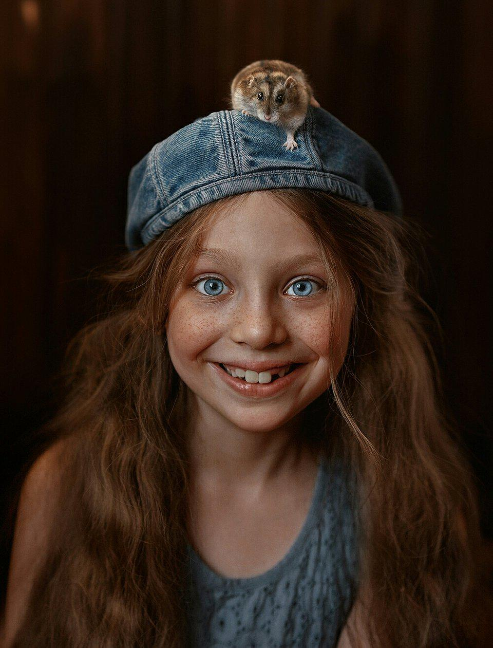 Redhead with hamster on her head