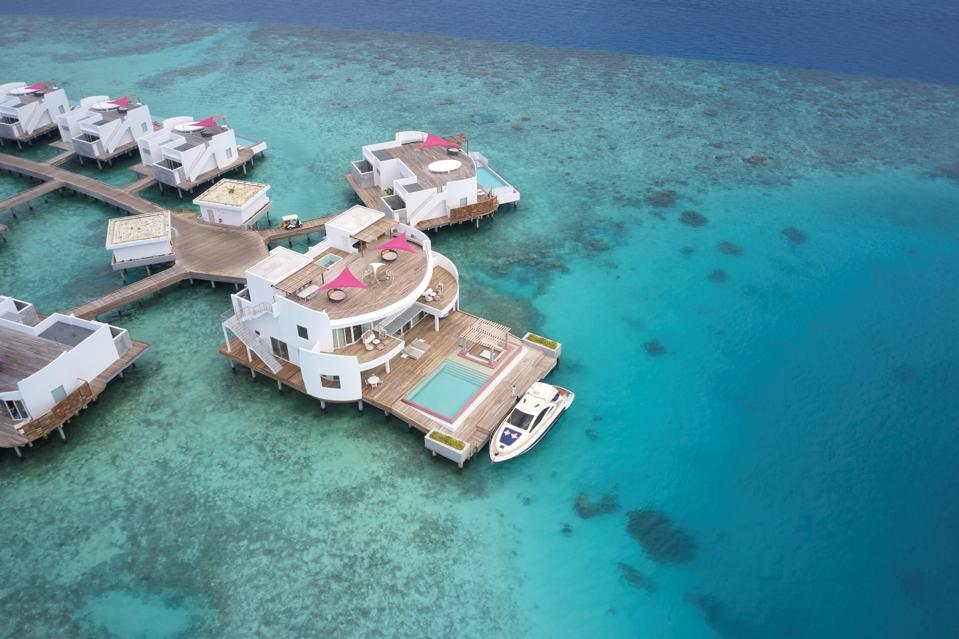 Overwater villa with yacht at LUX* North Male Atoll Resort & Villas
