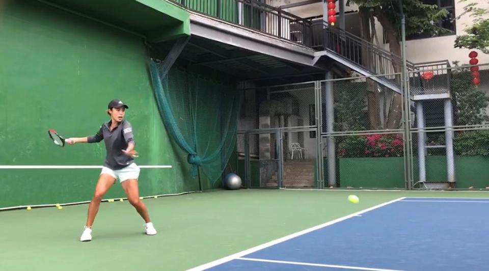 Wang Qiang works on her tennis form, back home in Tianjin, China