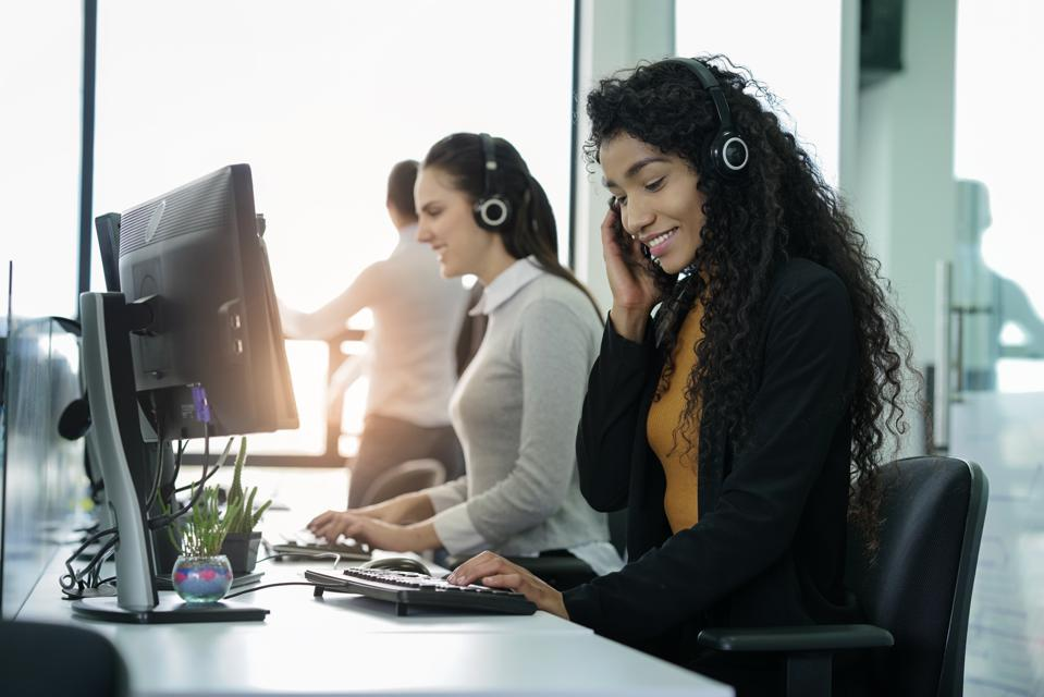 Women sitting in a call center