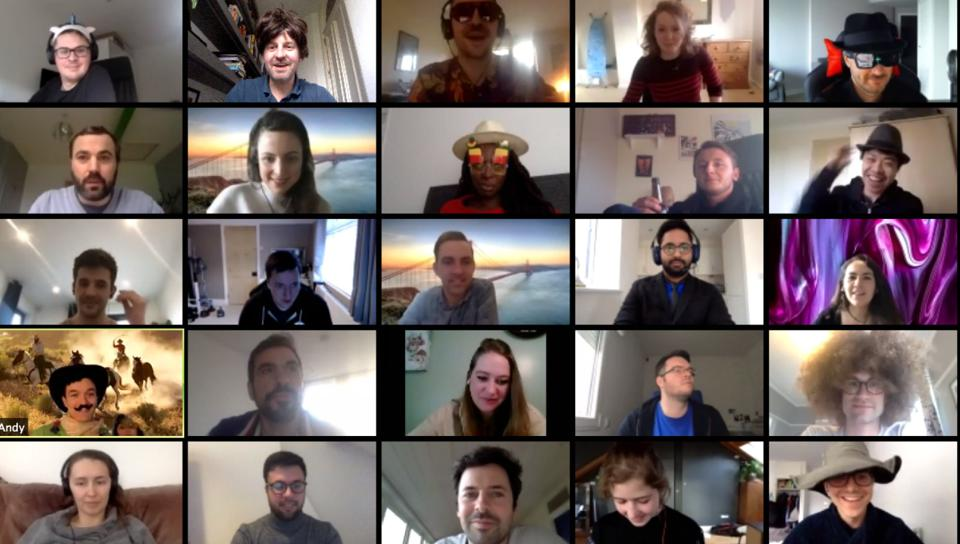 Video conference screen with employees smiling as they work on a culture initiative